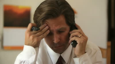 stock-footage-stressed-salesman-making-a-call-on-the-phone