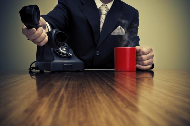 Businessman and retro phone