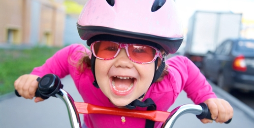 girl-on-bike-bike-helmet