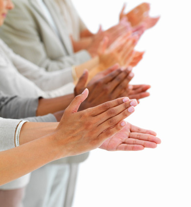 Closeup of business people clapping hands
